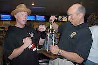Santa Monica Police Chief Timothy J. Jackman's team beats Santa Monica Fire Chief Scott Ferguson's team and receives the first place trophy while Chief Ferguson gets a bottle of ketchup during the Fifteenth Annual  SuperBowl-A-Thon at AMF Bay Shore Lanes on Friday, Feb. 4, 2011. The  tradition of receiving a bottle of ketchup for second place dates back to the 1917 Opening Day Ceremonies of the Santa Monica Bowling Alleys.