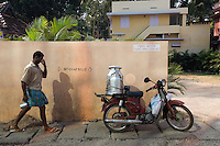 January 25th 2008 _Trivandrum, India _A delivery man prepares to ride off on his motorcycle in a small street in Trivandrum, which is the capital city of the Southern Indian state of Karala. Photograph by Daniel J. Groshong/Tayo Photo Group