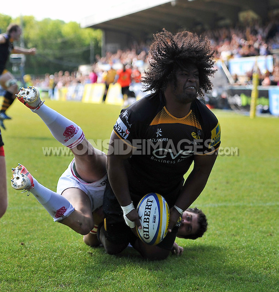 Ashley Johnson celebrates scoring a try for Wasps. European Champions Cup play-off, between London Wasps and Stade Francais on May 18, 2014 at Adams Park in High Wycombe, England. Photo by: Patrick Khachfe / JMP