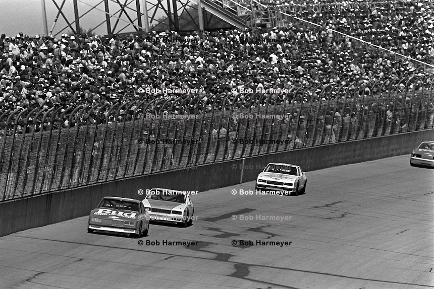 BROOKLYN, MI - AUGUST 11: Neil Bonnett drives his Junior Johnson Chevrolet at the front of a group of cars during the Champion Spark Plug 400 NASCAR Winston Cup race at the Michigan International Speedway near Brooklyn, Michigan, on August 11, 1985...