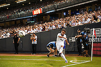 Mesut Ozil (10) of Real Madrid takes a corner kick. Real Madrid defeated A. C. Milan 5-1 during a 2012 Herbalife World Football Challenge match at Yankee Stadium in New York, NY, on August 8, 2012.
