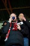 Barnsley 1 Millwall 0, 22/02/2014. Oakwell, Championship. Millwall make the journey from south London to South Yorkshire for a Championship relegation battle with Barnsley. A Barnsley supporter keep warm with a flask of tea.  Photo by Simon Gill.