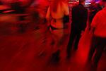 ISRAEL Tel Aviv<br /> A man and a stripper walk through the crowd during the first Israeli Sex Fair.