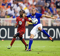 Joseph Ngwenya (11) of D.C. United has the ball cleared away from him by John Heitinga (5) of Everton during their friendly match held at RFK Stadium in Washington, DC.  D.C. United lost to Everton, 3-1.