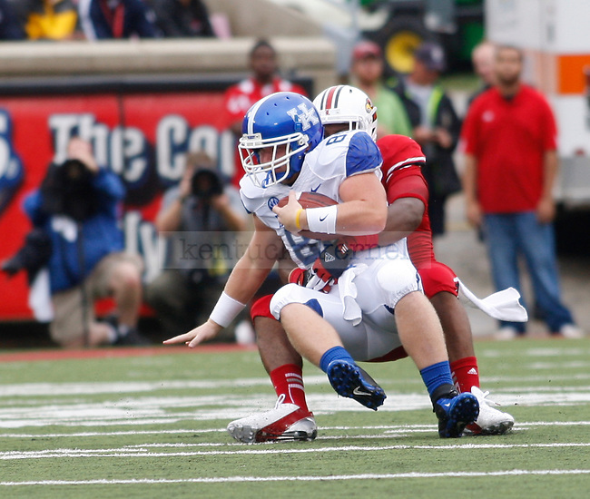 Junior tight end Tyler Robinson gets tackled during the first half of the UK vs. UL football game at Papa John's Cardinal Stadium in Louisville, Ky., on Sunday, September 2, 2012. Photo by Tessa Lighty | Staff