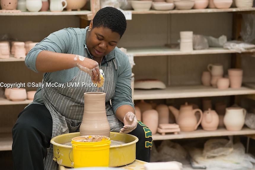 Student Miriam Richter at the UVM Pottery studio