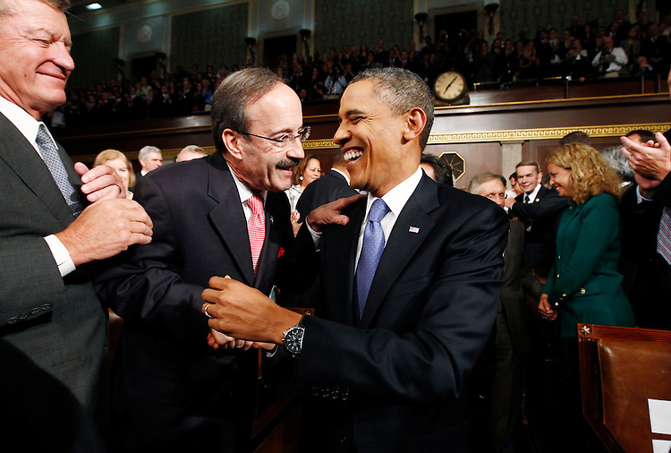 President Barack Obama laughs with Congressman Eliot Engle (C) as Obama arrived to address a joint session of the United States Congress on the subject of job creation on Capitol Hill in Washington, September 8, 2011.   REUTERS/Kevin Lamarque  (UNITED STATES)