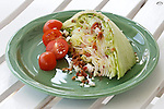 Wedge Salad: Iceberg lettuce, tomatoe, bacon and blue cheese with Vinaigrette dressing.
