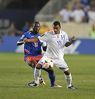Rony Martinez (11) of Honduras shields the ball against Ives Hadley (15) of Haiti.  Honduras defeated Haiti 2-0 in the first round of the CONCACAF Gold Cup, at Red Bull Arena, Monday July 8 , 2013.