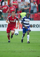 24 July 2010: FC Dallas defender Jair Benitez #5 and Toronto FC forward Chad Barrett #19 in action during a game between FC Dallas and Toronto FC at BMO Field in Toronto..The final score was a 1-1 draw...