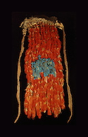 Sash of tropical macaw feathers on a tassel-eared squirrel's pelt, evidence of long distance trade and rich ceremonial traditions, from Edge of the Cedars State Park, Blanding, Utah, in the collection of the Anasazi Heritage Center, an archaeological museum of Native American pueblo and hunter-gatherer cultures, Dolores, Colorado, USA. Picture by Manuel Cohen