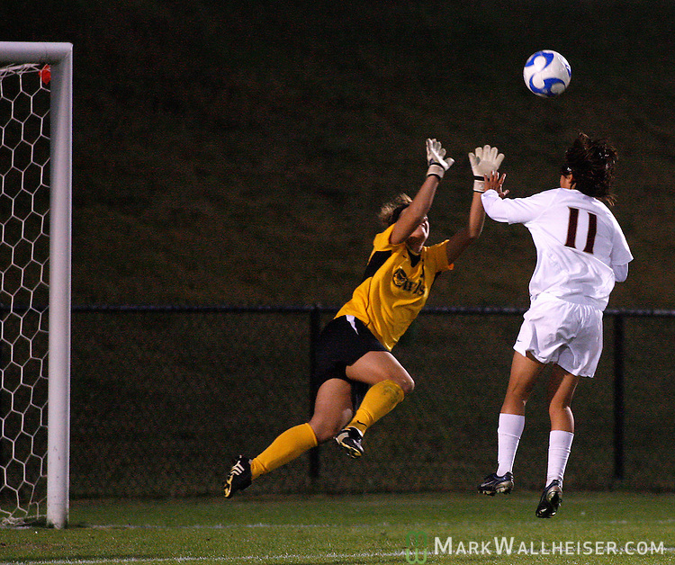 iThe  Kennesaw State Owls' goalie Katie Piotrowski, left, cuts off a pass intended for Mami Yamaguchi in the second half of first round NCAA soccer action in Tallahassee November 16, 2007.(Mark Wallheiser/TallahasseeStock.com)