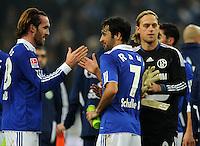 FUSSBALL   1. BUNDESLIGA   SAISON 2011/2012   22. SPIELTAG FC Schalke 04 - VfL Wolfsburg         19.02.2012 Christian Fuchs, Raul und Timo Hildebrand (v.l., alle Schalke)