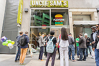Uncle Sam's, the first store in the U.S. of the Chinese burger chain opens on Fifth Avenue in Midtown at the auspicious time of 2:18 PM on Monday, May 18, 2015. The New York flagship restaurant serves hamburgers with an Asian twist to them using Chinese and Korean ingredients as sauces and toppings. (© Richard B. Levine)