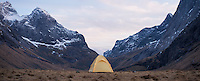 Tent with scenic mountain backdrop while wild camping at Horseid beach, Moskenesøy, Lofoten Islands, Norway