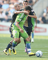 Fred #7 of the Philadelphia Union pushes into the back of Fredy Montero #17 of the Seattle Sounders FC during the first MLS match at PPL stadium in Chester, PA. on June 27 2010. Union won 3-1.