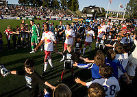 Earthquakes and Red Bull players walk on the field through the fans before the game at Buck Shaw Stadium in Santa Clara, California.  San Jose Earthquakes defeated New York Red Bulls, 4-0.
