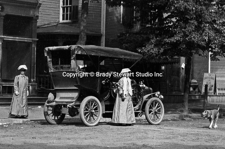 Irwin PA:  Brady Stewart and friends traveled on the Pittsburgh Greensburg turnpike and stopped off in in a town along the way.  The women are sporting new motoring clothes