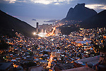 View of São Conrado merges with Rocinha, the biggest favela in Brazil, with over 100,000 residents, in Rio de Janeiro, Br., on Thursday, Jan. 24, 2013. About 3,000 police officers and soldiers moved into one of the largest slums in Latin America early November 2011 in an effort by the Brazilian government to assert control over lawless areas of the city ahead of the 2014 World Cup and 2016 Summer Olympics.