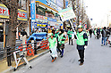 "January 23, 2011, Tokyo, Japan - Members of the governing board of ""Pedestrian Paradise"" patrol Tokyofs Akihabara district on Sunday, January 23, 2011. A record crowd of about 100,000 shoppers and tourists returned to Japanfs electronics capital as the pedestrian-only shopping zone reopened for the first time in two years and seven months after the 2008 stabbing rampage that left seven dead and 10 others injured. (Photo by AFLO) [3620] -mis-"
