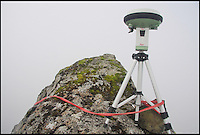 BNPS.co.uk (01202 558833)<br /> PIC: G&amp;JSurveys/BNPS<br /> <br /> ***Please use full byline***<br /> <br /> The Leica GS15 on the summit of Knight's Peak.<br /> <br /> <br /> Three ramblers have stripped a remote mountain in the Scottish Highlands of its status after measuring it at six inches below the official height.<br /> <br /> Intrepid hillwalkers John Barnard, Graham Jackson and Myrddyn Phillips set out to complete Britain's most daring mountain survey on Knight's Peak on the Isle of Skye.<br /> <br /> Maps list the jagged rocky peak in the Cuillin mountain range at 3,002ft high, just two feet above the 3,000ft required height for mountain status.<br /> <br /> However it has long been a source of controversy among hillwalkers who suspected it fell short of the height given on the maps.