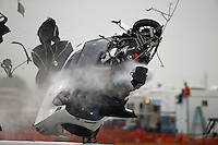 Apr 29, 2016; Baytown, TX, USA; NHRA  pro mod driver Sidnei Frigo flies through the air as he crashes during qualifying for the Spring Nationals at Royal Purple Raceway. Frigo was alert and transported via helicopter to a local hospital. Mandatory Credit: Mark J. Rebilas-USA TODAY Sports