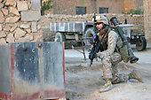 U.S. Marine Corps Cpl. Steve D. Depreaux, from India Company, 3rd Battalion, 3rd Marine Regiment, pulls security during a patrol in Haditha, Iraq, Aug. 5, 2006. (U.S. Marine Corps photo by Cpl. Brian M. Henner) (Released)