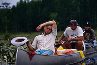 Ornithology students take a break in the heat while paddling through the Okefenokee National Wildlife Refuge on a wilderness trip.