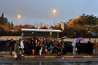 People wait for a public bus going north, as they leave the southern city of Beersheba, after consecutive days of missile attacks. Israeli forces began an air offensive against Hamas in the Gaza Strip on 27/12/2008, which quickly escalated into an offensive by land, sea and air, in retaliation against Palestinian rockets fired into Israel. After eight days of bombardment, leaving over 400 Palestinians and four Israelis dead, Israeli tanks entered Gaza on 04/01/2009...