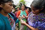 Aurelia Jimenez Zacariaz (right) injects a pig as other women watch during a workshop at an eco-agricultural training center in Comitancillo, Guatemala. The center is sponsored by the Maya Mam Association for Investigation and Development (AMMID).