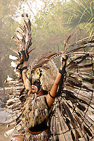 Feathered owl dancer performing at the recreation of an ancient Mayan market, Sacred Mayan Journey 2011 event, Riviera Maya, Quintana Roo, Mexico