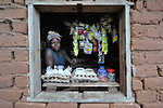 Tchaka Harazi is living with HIV and taking antiretroviral medications. Profits from the little store she runs in a window of her home in Ekwendeni, Malawi, support her and four orphans she is caring for.