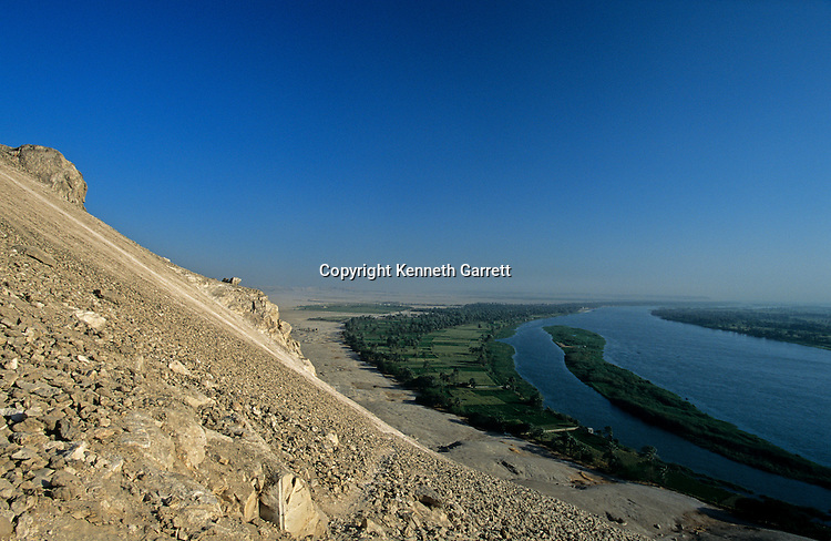 Nile River scenic where the desert meets the fertile area, Amarna site in background, Egypt