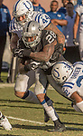 Indianapolis Colts inside linebacker Antonio Morrison (44) and free safety T.J. Green (32) tackle Oakland Raiders running back Latavius Murray (28) on Saturday, December 24, 2016, at O.co Coliseum in Oakland, California.  The Raiders defeated the Colts 33-25.