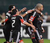 D.C. United forward Maicon Santos (29) celebrates with teammates his first goal of the game in the 28th minute of the game. D.C. United defeated FC Dallas 4-1 at RFK Stadium, Friday March 30, 2012.