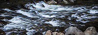 Flowing water, agitated by the rocky riverbed, is smoothed and made silky by slow shutter.  Truckee River, Sierra Nevada Mountains.  Cropped to 8.5X3 perspective.