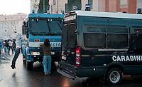 Roma  15 Ottobre 2011.Manifestazione contro la crisi e l'austerità.Scontri tra manifestanti e forze dell'ordine.Manifestanti tentano di fermare i blindati in piazza San Giovannii .