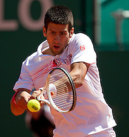 Novak DJOKOVIC (SRB) against Florent SERRA (FRA) in the second round. Novak Djokovic beat Florent Serra 6-2 6-3..International Tennis - 2010 ATP World Tour - Masters 1000 - Monte-Carlo Rolex Masters - Monte-Carlo Country Club - Alpes-Maritimes - France..© AMN Images, Barry House, 20-22 Worple Road, London, SW19 4DH.Tel -  + 44 20 8947 0100.Fax - + 44 20 8947 0117