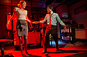 """London, UK. 17/07/2011.  """"Mongrel Island"""", by Ed Harris, and presented at the Soho Theatre, offers a fresh, cynical and offbeat perspective on how the workplace can strip away our humanity. Robyn Addison as Marie and Shane Zaza as Elvis. Photo credit should read Jane Hobson"""