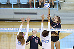 10 September 2015: Stanford's Ivana Vanjak (GER) (7) hits the ball over North Carolina's Taylor Treacy (20) and Paige Neuenfeldt (left). The University of North Carolina Tar Heels hosted the Stanford University Cardinal at Carmichael Arena in Chapel Hill, NC in a 2015 NCAA Division I Women's Volleyball contest. North Carolina won the match 25-17, 27-25, 25-22.