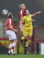 Gilly Flaherty of Arsenal rises above Eva Bartonova - Arsenal Ladies vs Sparta Prague - UEFA Women's Champions League at Boreham Wood FC - 11/11/09 - MANDATORY CREDIT: Gavin Ellis/TGSPHOTO - Self billing applies where appropriate - Tel: 0845 094 6026