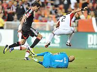 New England Revolution goalkeeper Mat Reis (1) goes against D.C. United midfielder Chris Pontius (13) D.C. United defeated The New England Revolution 2-1 at RFK Stadium, Saturday September 15, 2012.