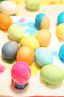 Photo of Brightly Colored Easter Eggs on a Napkin.