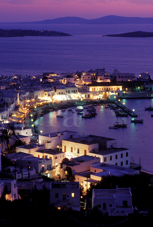 Mykonos, Greek Islands, Cyclades, Greece, Europe, Scenic view of Mykonos Harbor in the evening on the Aegean Sea.