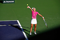 16 March 2007: Sybille Bammer (AUT) in pink is defeated by Svetlana Kuznetsova (RUS) during a very long three set match on the main court at the 2007 Pacific Life Open Tennis Tournament in Indian Wells, CA.  Shadow of female player making a serve.