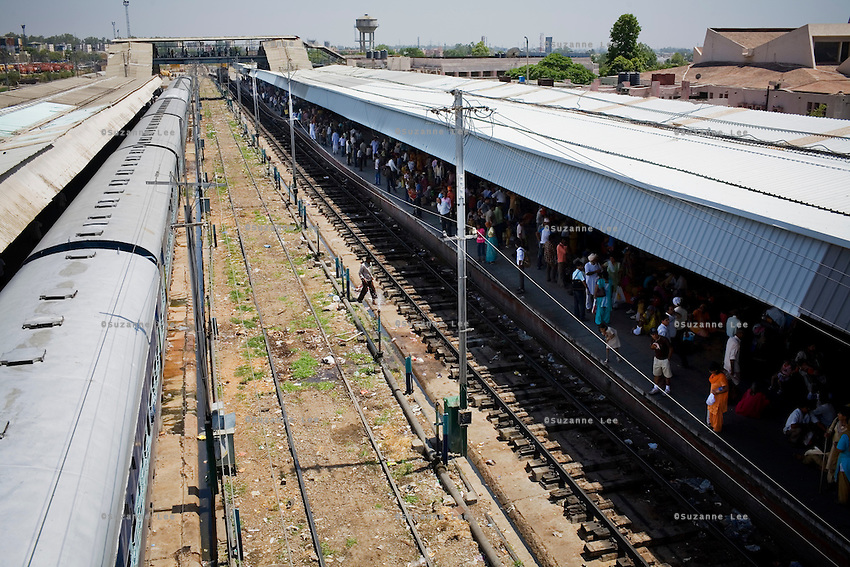Passengers wait on the platforms at Jammu Tawi Station in Jammu, J&K, as the Himsagar Express 6317 pulls in to the final station after its four day journey from Kanyakumari on 6th July 2009.. .6318 / Himsagar Express, India's longest single train journey, spanning over 3720 kms, going from the mountains (Hima) to the seas (Sagar), from Jammu and Kashmir state in the Indian Himalayas to Kanyakumari, the southern-most tip of India...Photo by Suzanne Lee / for The National