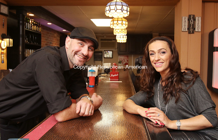 WATERBURY CT. 24 May 2016-052416SV02- From left, Fluturim and Elizabeta Sadiku are the new owners of Scruples on Watertown Avenue in Waterbury Tuesday. They renovated the bar and plan to serve pizza and other dinners. <br /> Steven Valenti Republican-American