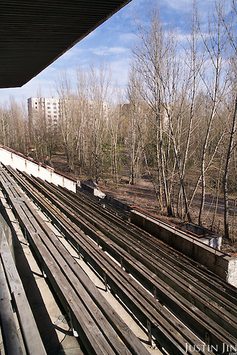 A sports stadium overgrown with trees in Pripyat, a ghost town left deserted by the nuclear disaster in the Chernobyl power station nearby. 30 years on, the city is still heavily contaminated, unfit for human life. <br /> <br /> The Chernobyl nuclear disaster happened on 26 April 1986.