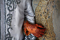 """Winda Wahyuni holds hands with her husband Ahmad Yasir Saputra after they got married in a mosque in Banda Aceh December 9, 2012. Winda and Ahmad Yasir, who met a year ago on the Facebook married in a religious ceremony in a local mosque in Banda Aceh. Dating on social networks become increasingly popular in Aceh where, under the Sharia law, it is a crime for an unmarried man and woman who are not related by blood to associate in an """"isolated place."""" Aceh is Indonesia's only province to have implemented Sharia or Islamic laws. Human right activists warn some of sharia laws in IndonesiaÕs Aceh province violate rights of many people - predominantly the poor, women, minority and youths.   REUTERS/Damir Sagolj (INDONESIA)"""