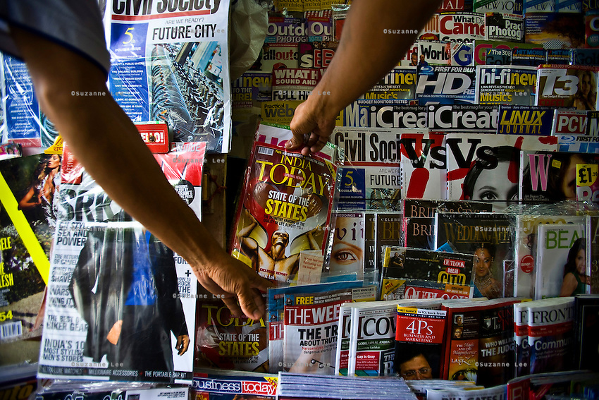 Customers pick up Indian and Indian versions of international magazines at a newsstand in Khan market in New Delhi on 18 September 2008. Photo : Suzanne Lee for The National.